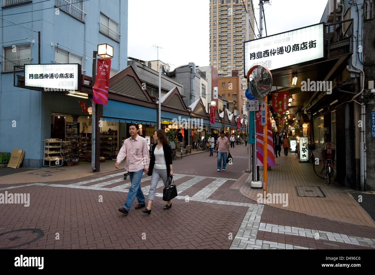 Street running through a manjayaki restaurant district, where one can enjoy Japanese okonomiyaki pizza, Tsukishima, - Stock Image