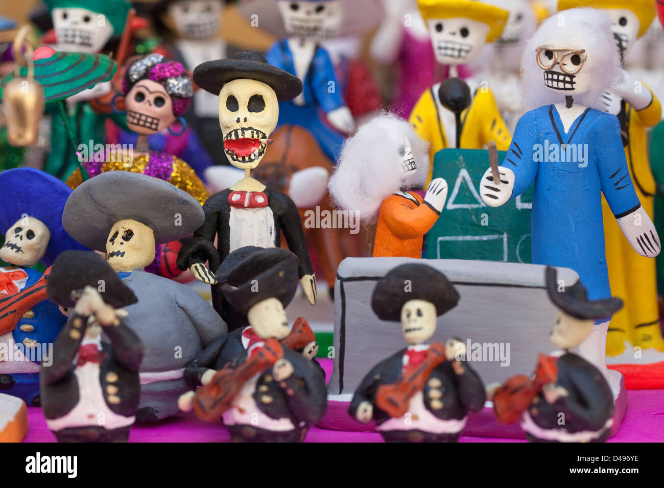 Small clay skeleton figurines on display for Day of the Dead festival, Oaxaca, Mexico. - Stock Image