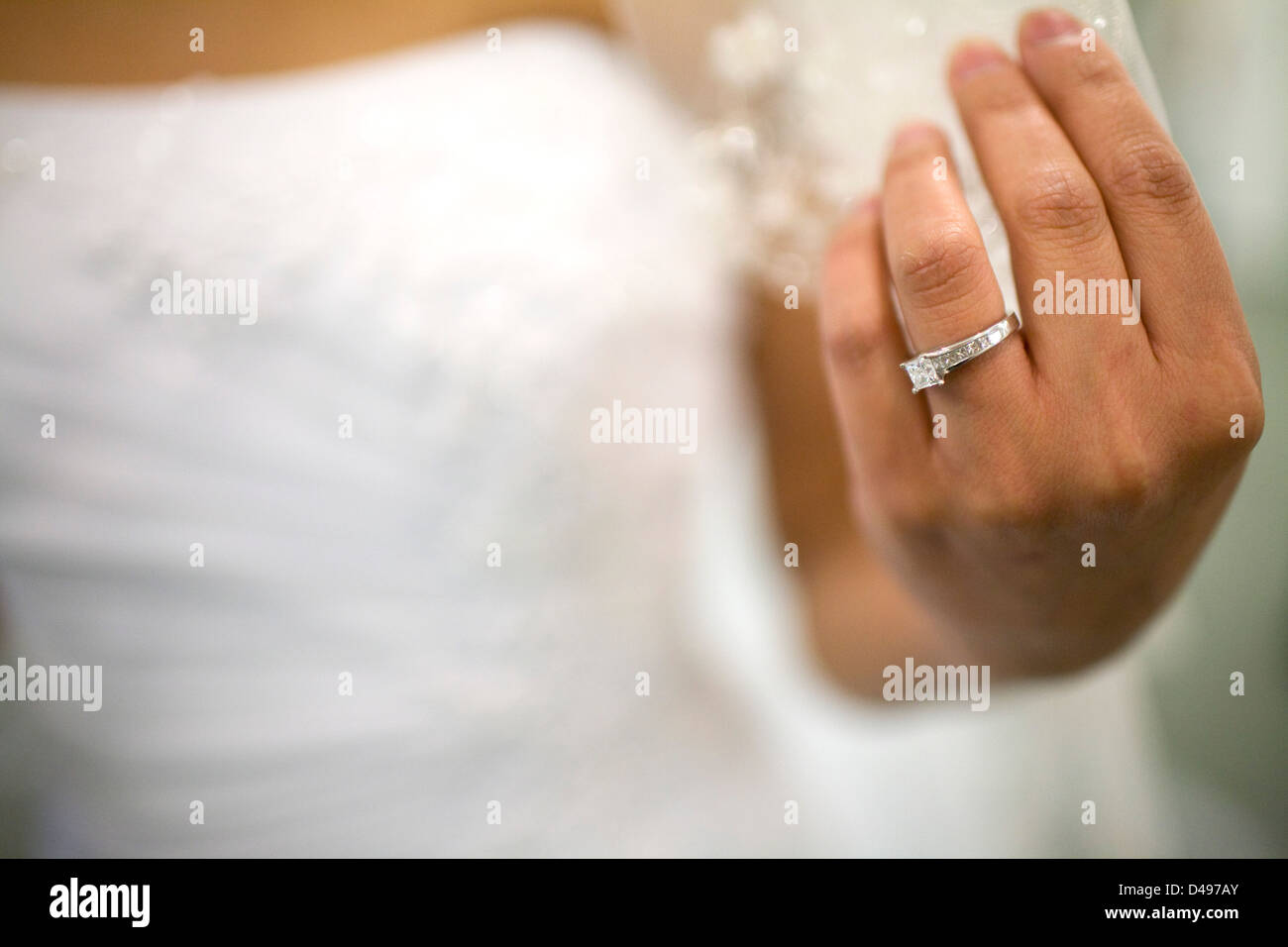A bride shows her engagement ring on her wedding day. - Stock Image