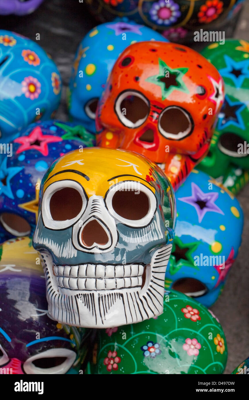 Closeup of handpainted ceramic skulls for sale at Zocalo during Day of the Dead, Oaxaca, Mexico. - Stock Image