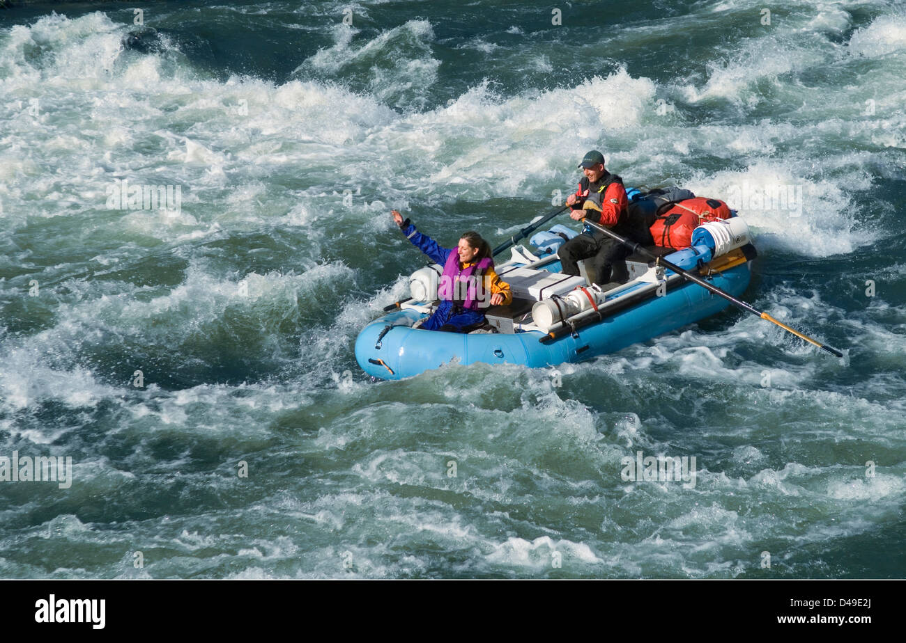 Whitewater rafting through Grave Creek Rapids on the Rogue River, Oregon. - Stock Image