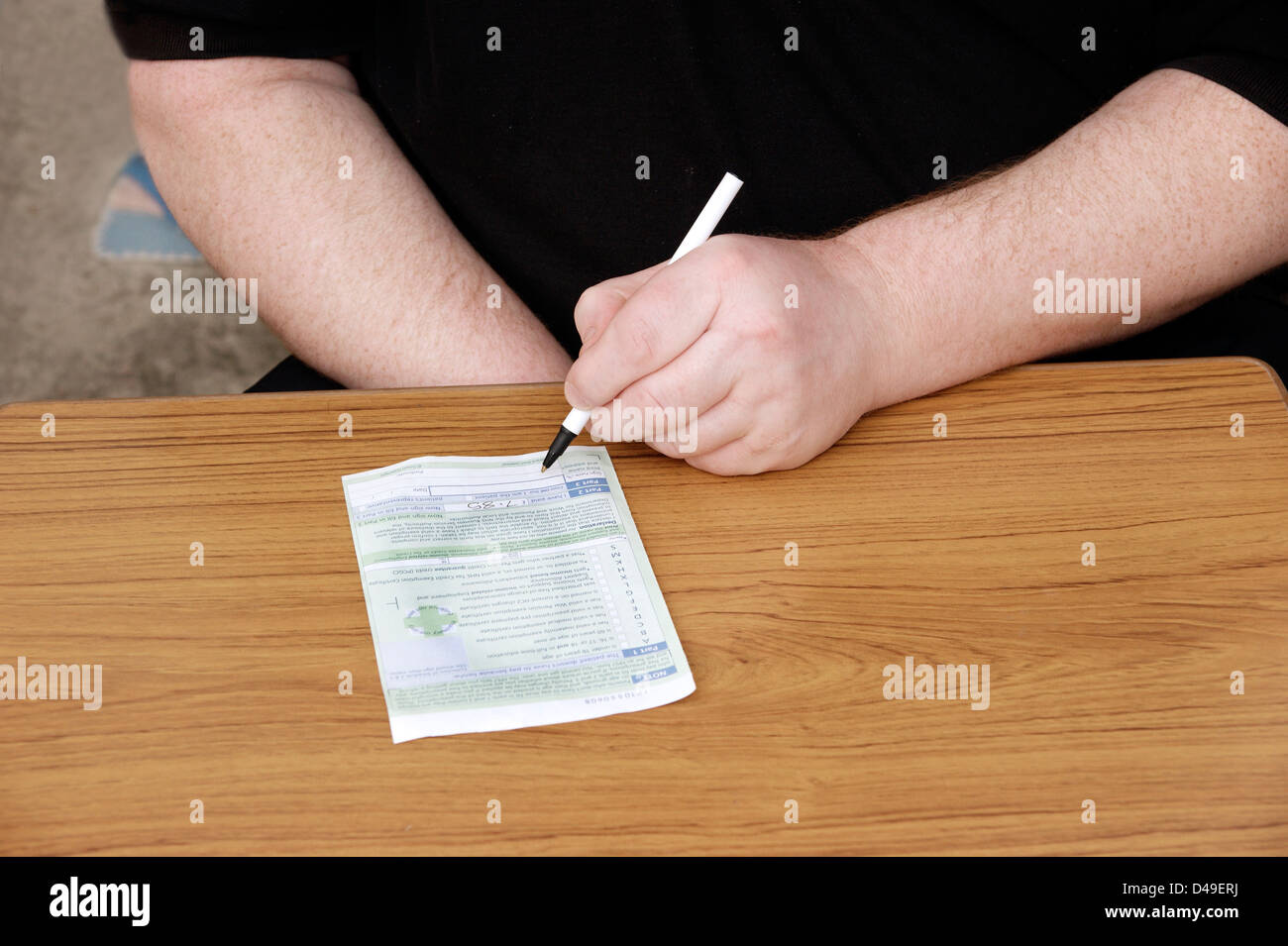 Man filling in back of prescription / prescriptions - Stock Image