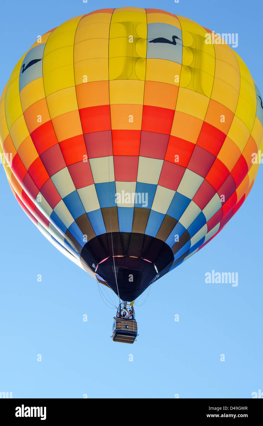 A Brightly Colored Hot Air Balloon Fills The Frame Against A Clear