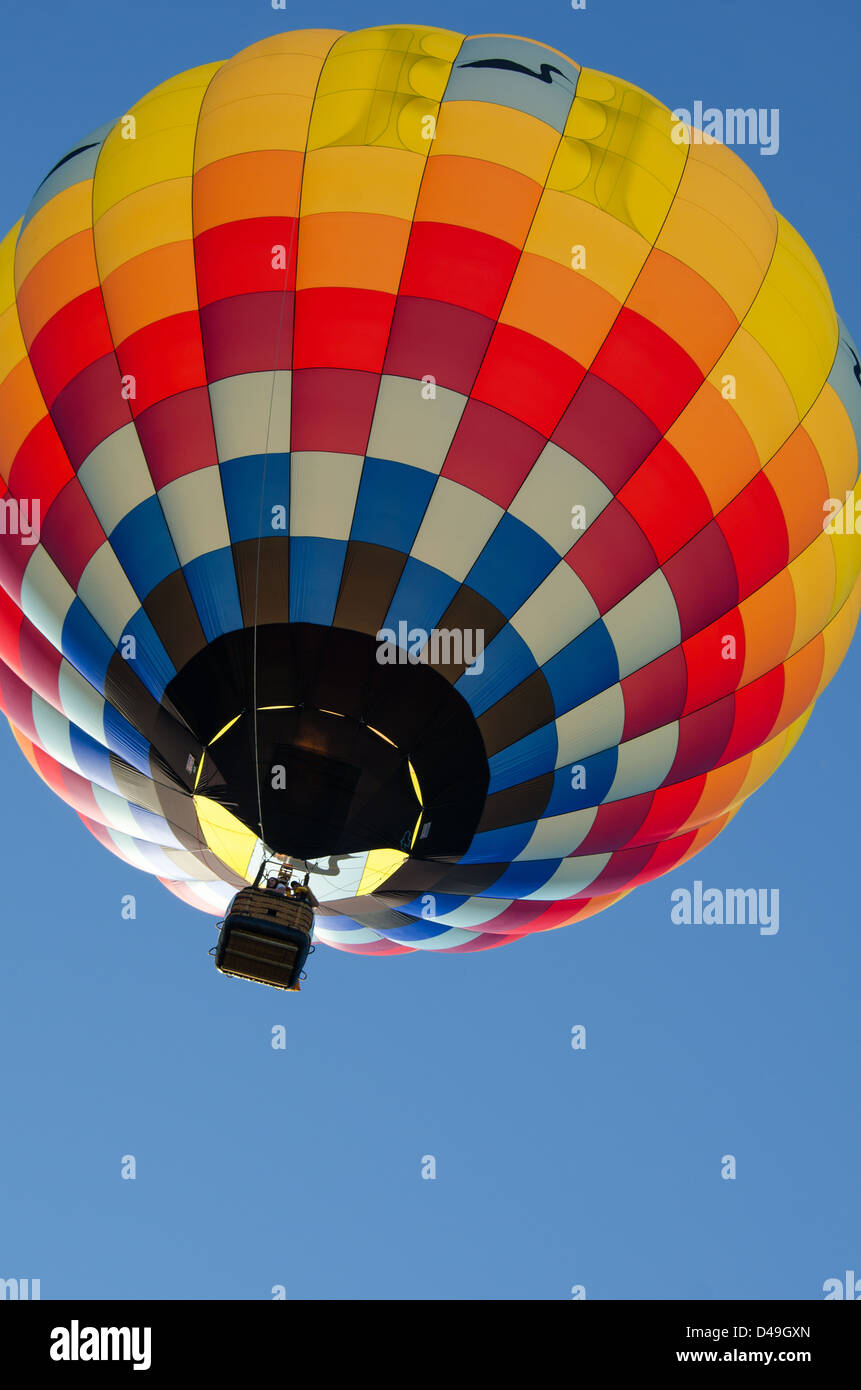 Brightly Colored Hot Air Balloon Fills The Frame Against A Deep Blue