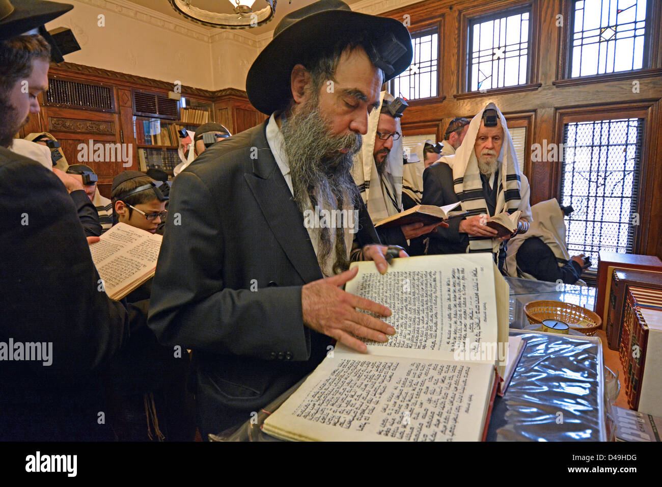 Weekday morning services in the Rebbe's office at Lubavitch Headquarters in Brooklyn, New York - Stock Image