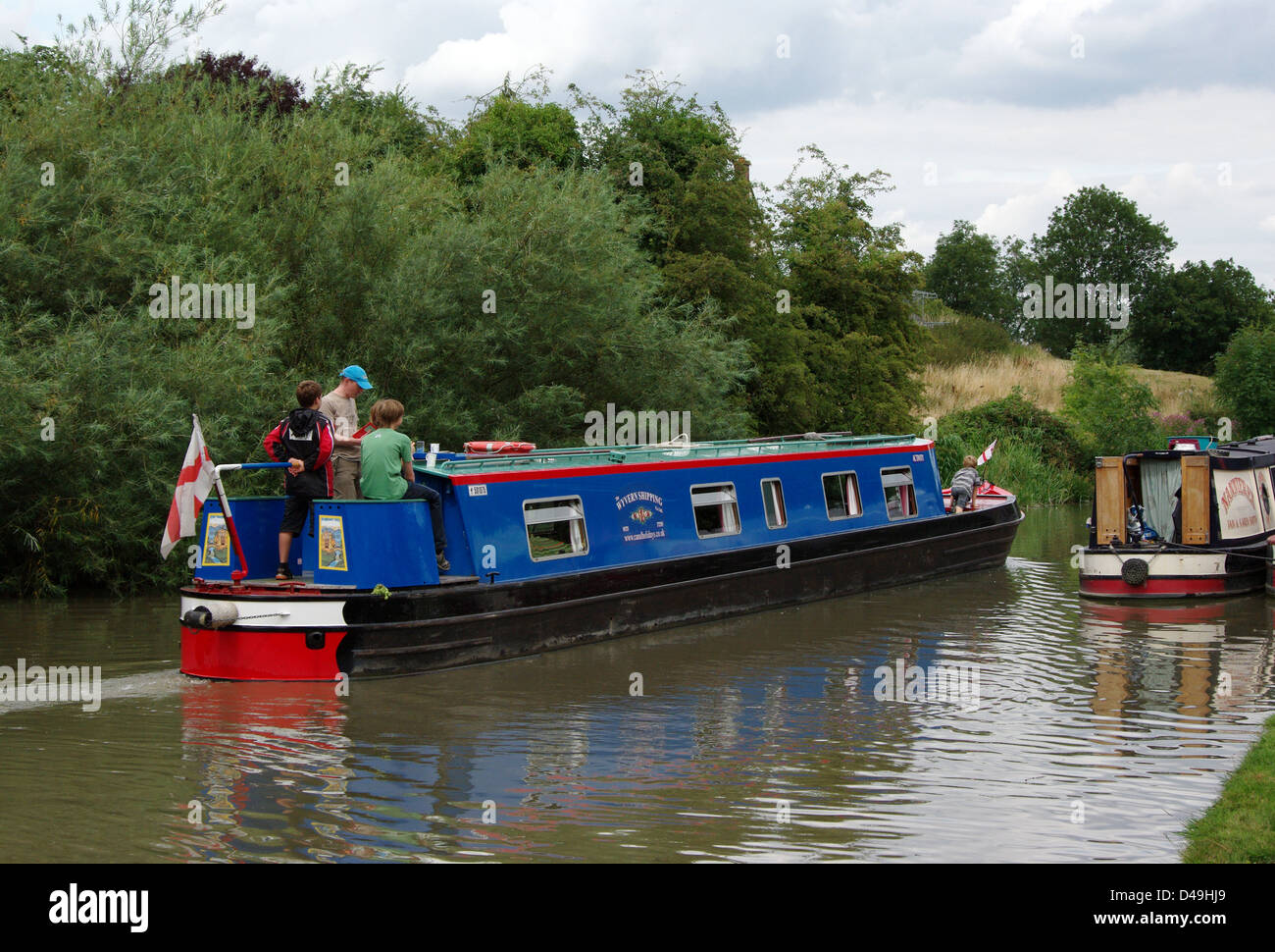 Two narrowboats passing, Grand Union Canal, Blisworth - Stock Image