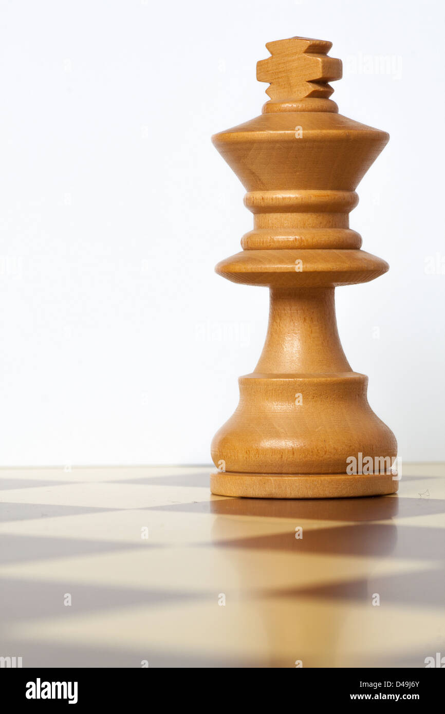 closeup of chess king piece over chessboard - Stock Image