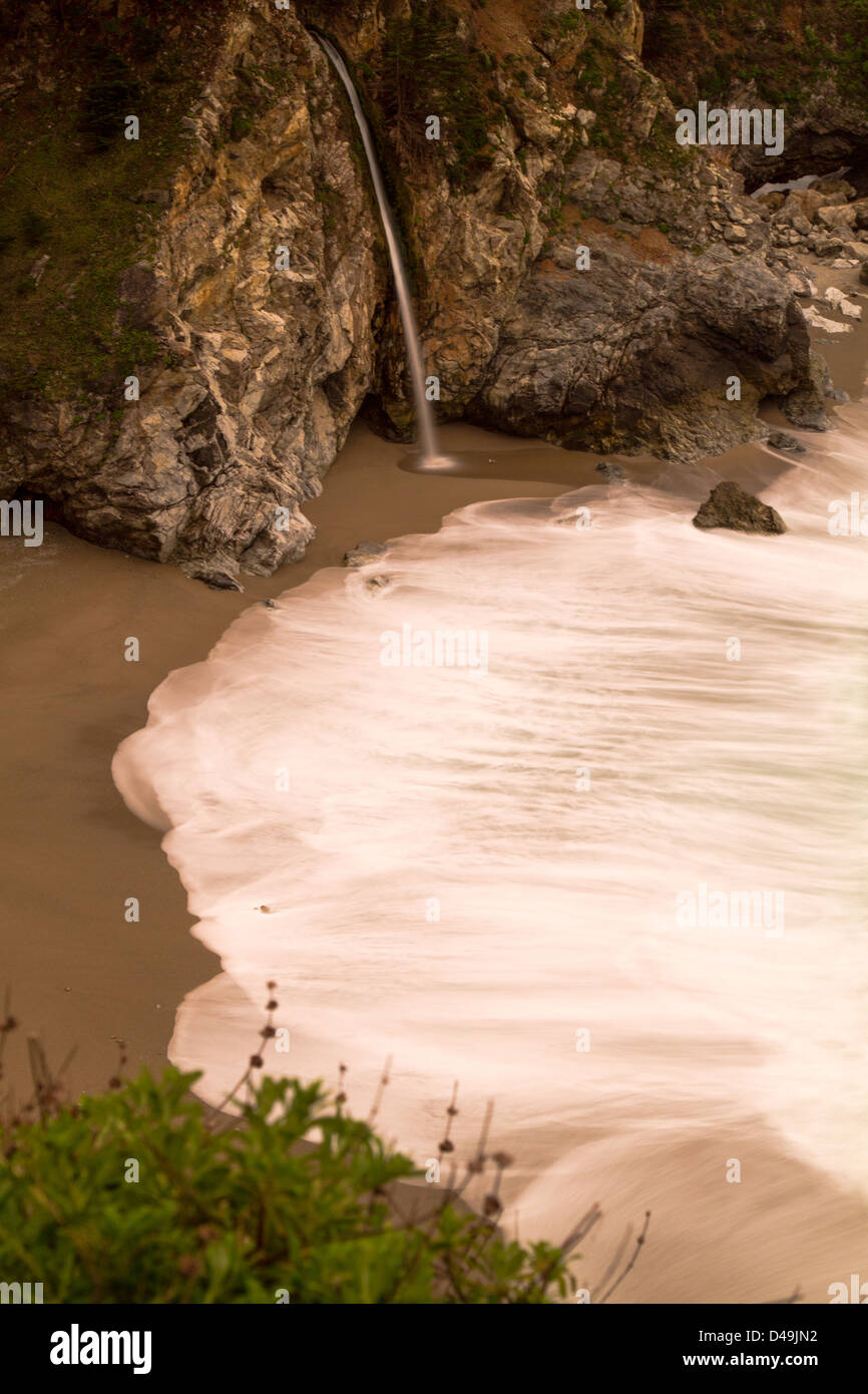 Long exposure shot of the lovely McWay Falls and beach in Big, Sur, California. - Stock Image