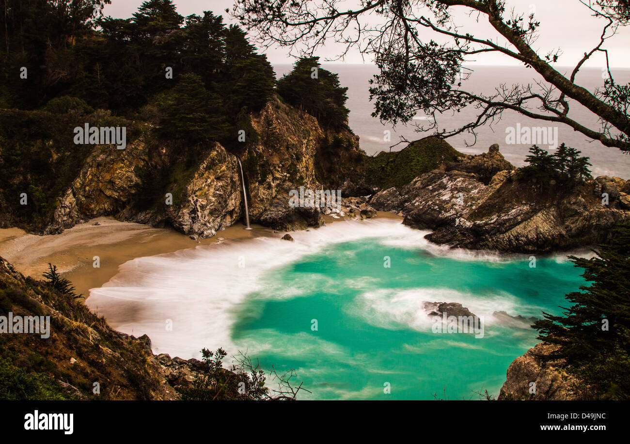 Long exposure shot of the lovely McWay Falls in Big, Sur, California. - Stock Image