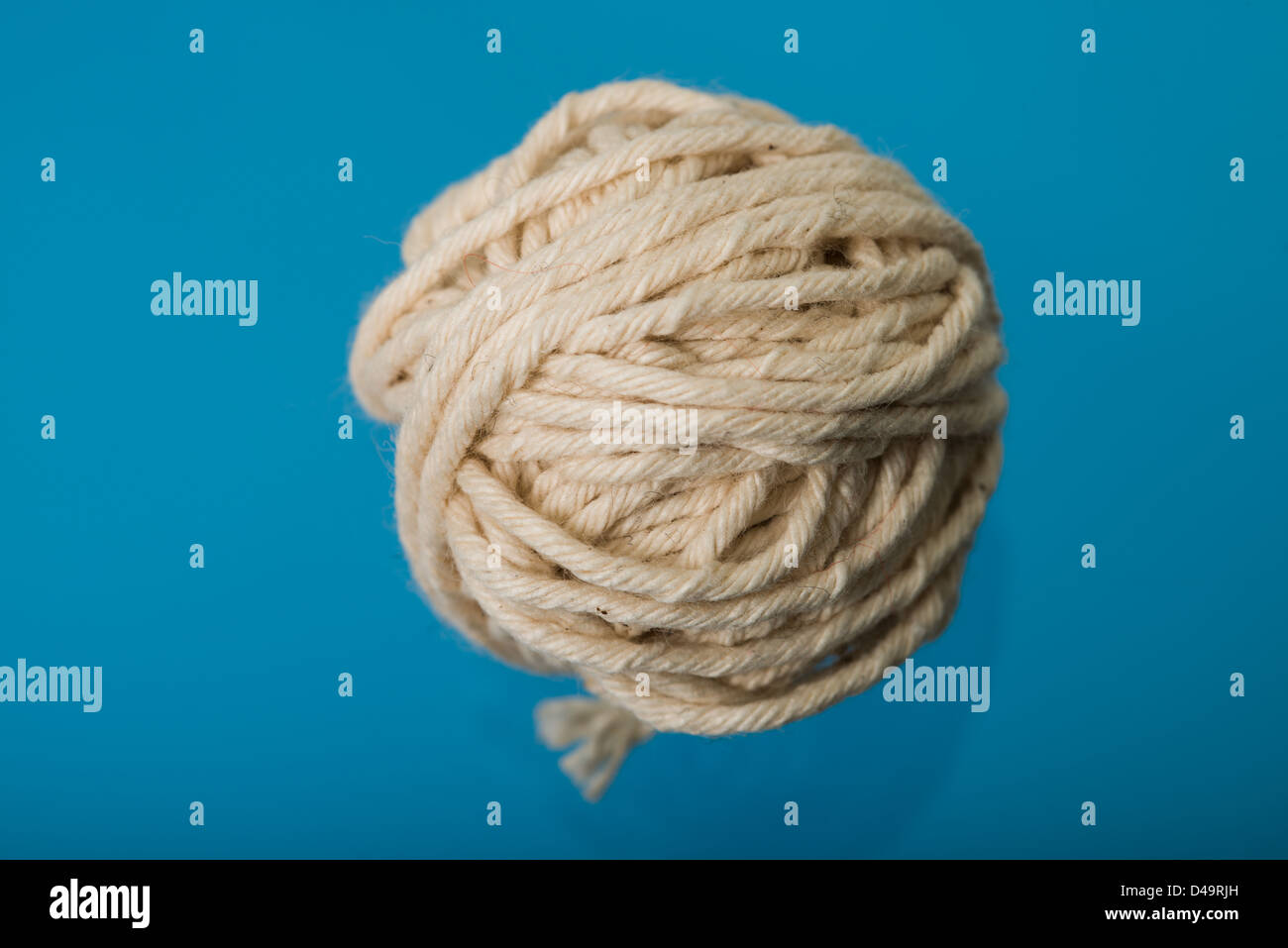 This is an image of a small ball of string - Stock Image