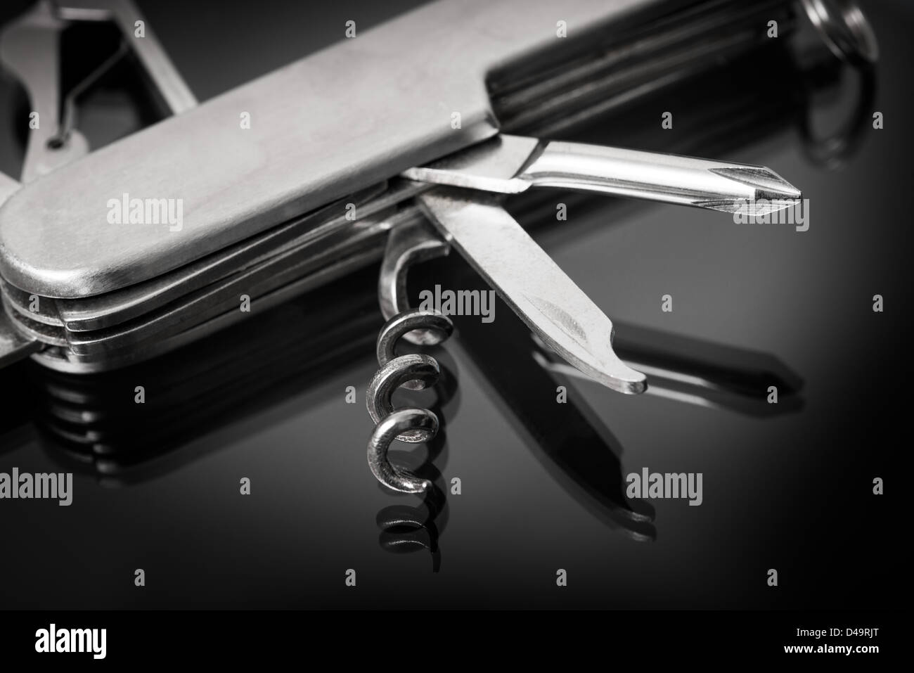 This is an image of a multi tool knife, scissors, screwdriver etc. - Stock Image