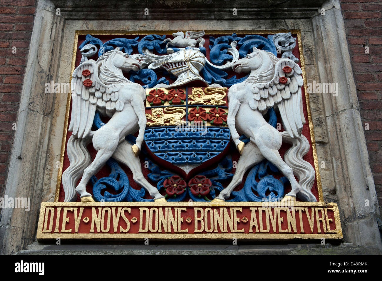The coat of arms above the entrance to the Merchant Adventurers' Hall - a medieval guildhall - in the city of - Stock Image