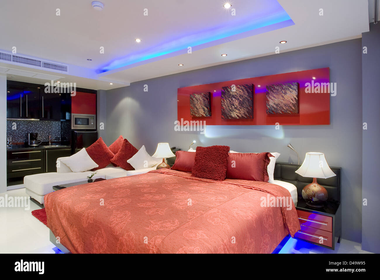 Panoramic view of nice stylish modern bedroom. Images on the wall were changed. - Stock Image