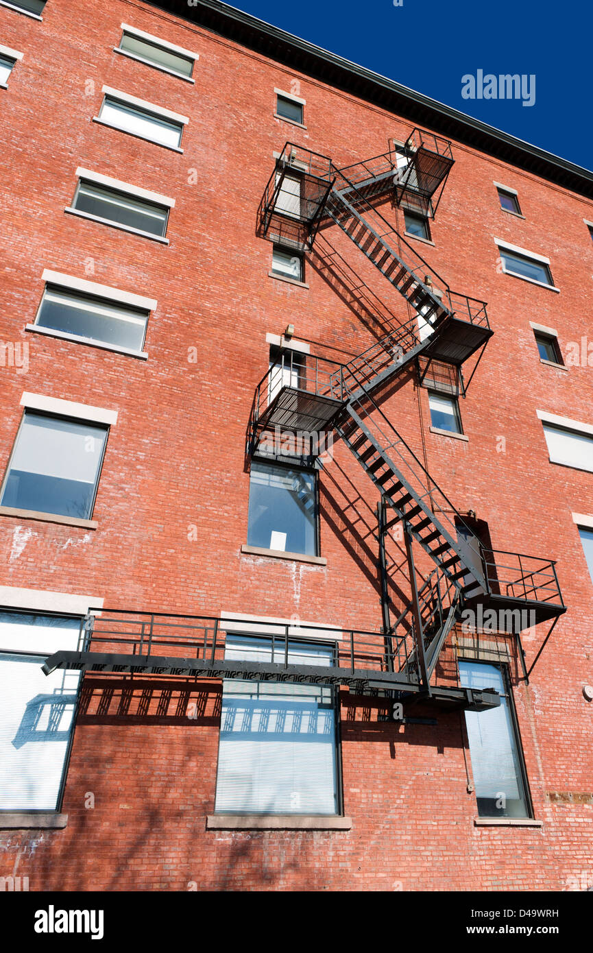Fire Escape Stairs On The Exterior Of An Apartment Building In Montreal,  Province Of Quebec