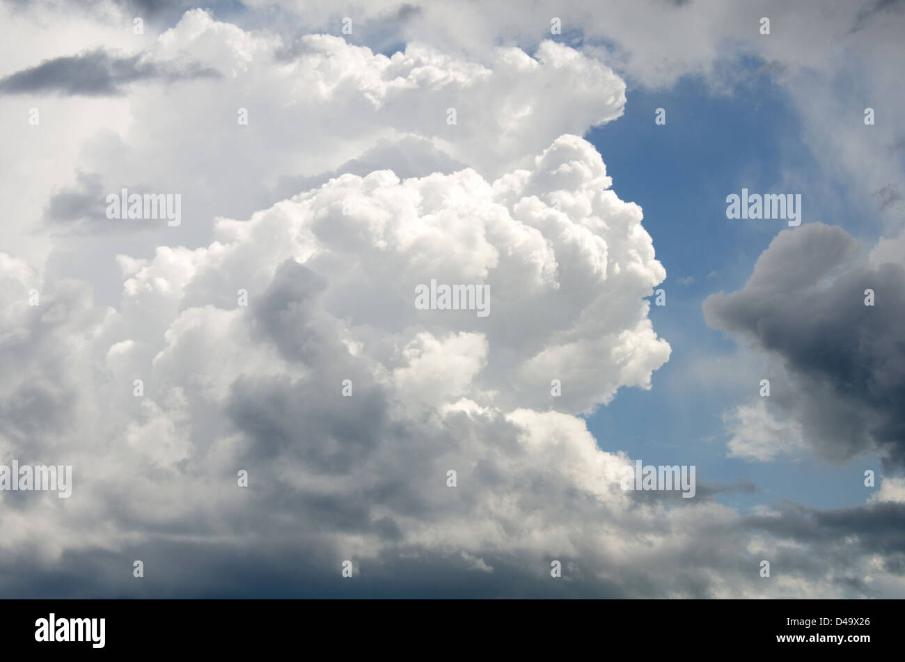Cumulonimbus clouds pile higher and higher as a rain storm builds over Campobello Island, New Brunswick - Stock Image