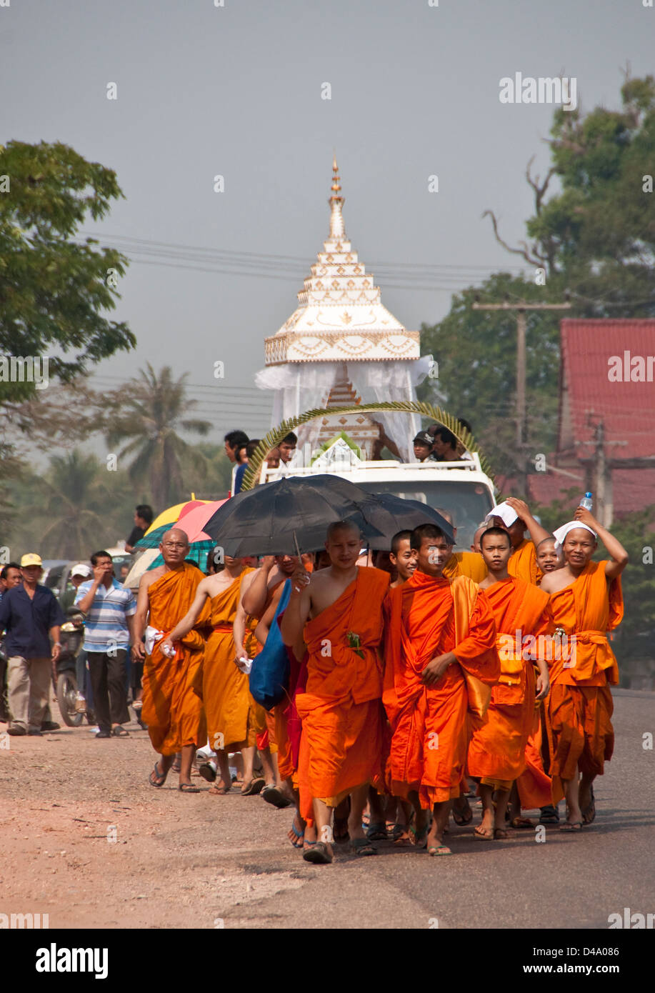 Buddhist monks leading funeral procession near Vientiane, Laos - Stock Image