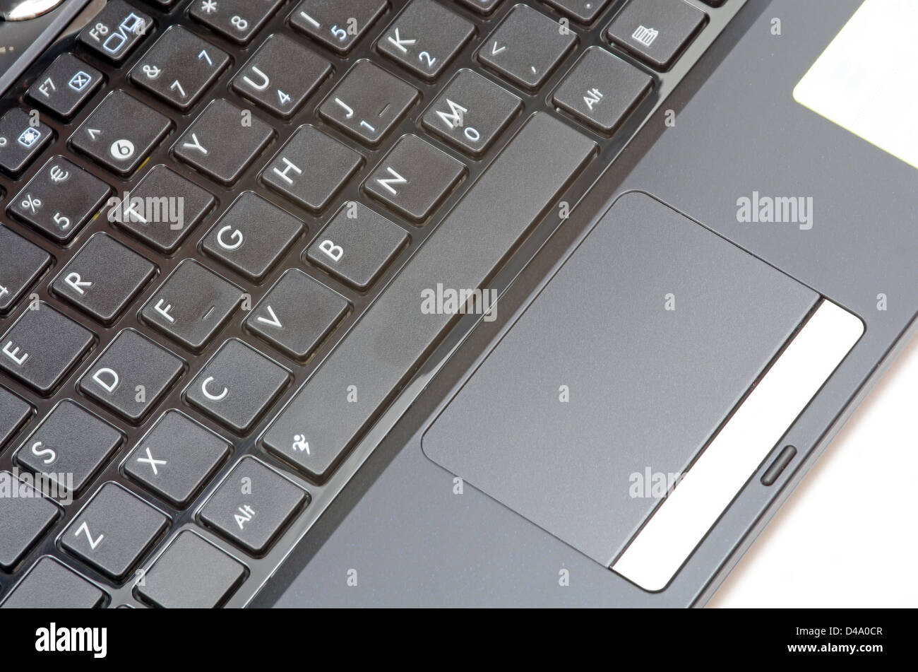 Netbook keyboard and mouse on white - Stock Image
