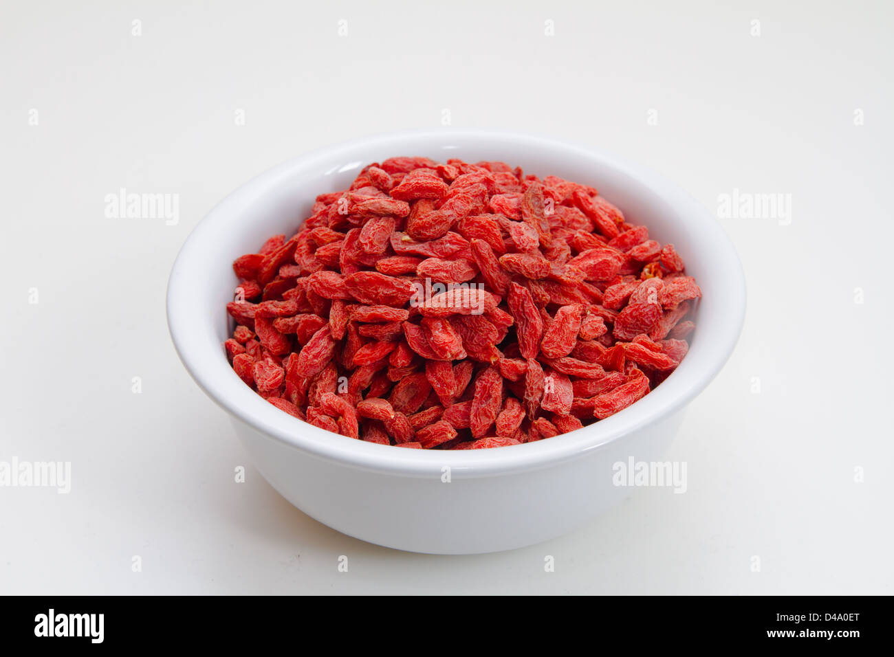 Dried goji berries in a bowl - Stock Image