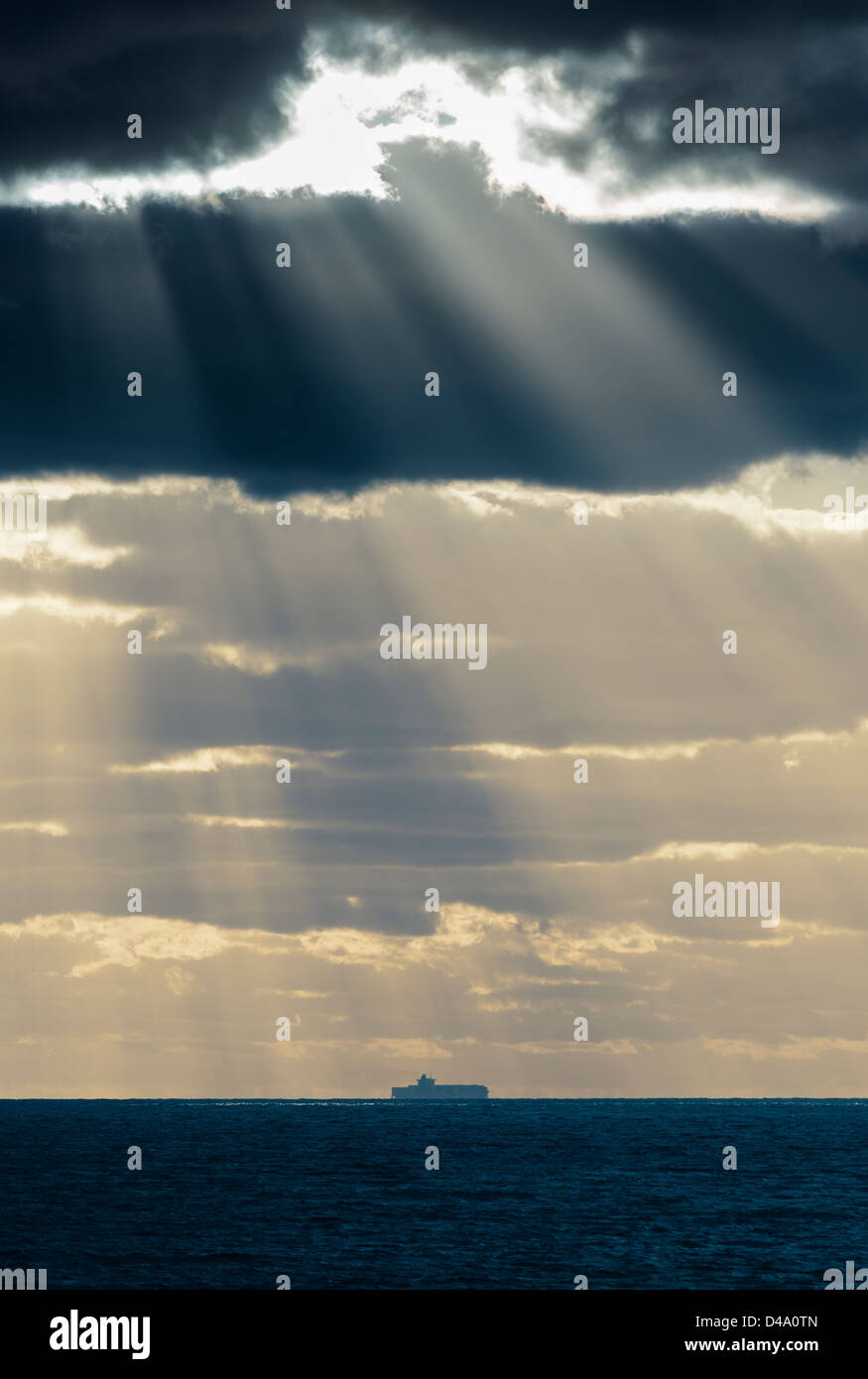 Sunshine though the clouds. - Stock Image