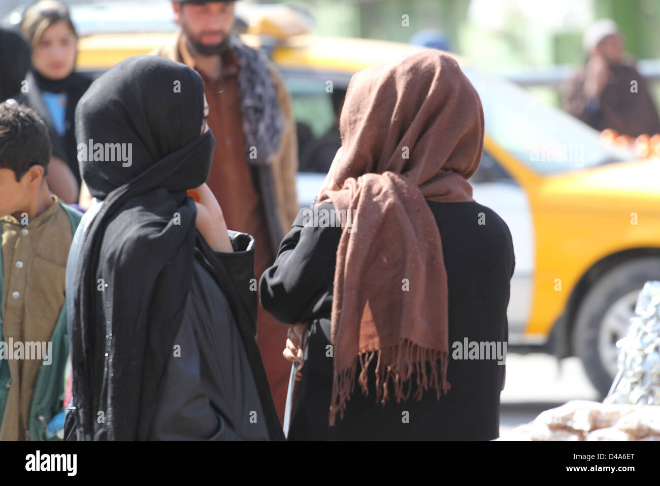 Two veiled women at a street market in Kabul, Afghanistan. - Stock Image