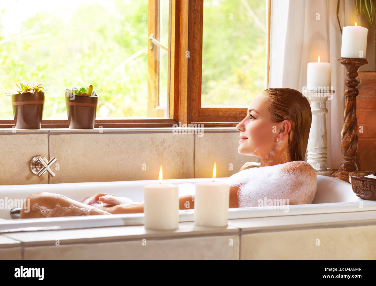 Picture Of Beautiful Woman Taking Bath At Home, Cute Female Lying Down In  Bathtub, Warm Candle Light, Romantic Atmosphere