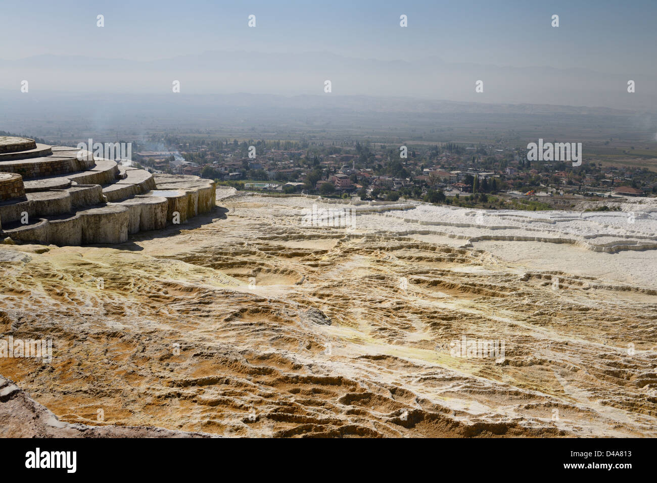 Lookout point over dry hot spring pools of travertine calcium carbonate mineral terraces at Pamukkale Turkey - Stock Image