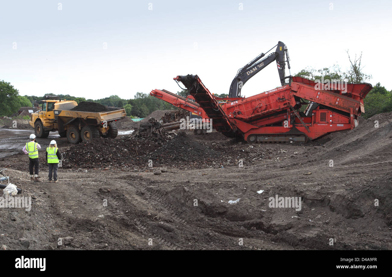 A mobile crushing and screening machine in operation on a land reclamation and decontamination project in Woking, - Stock Image