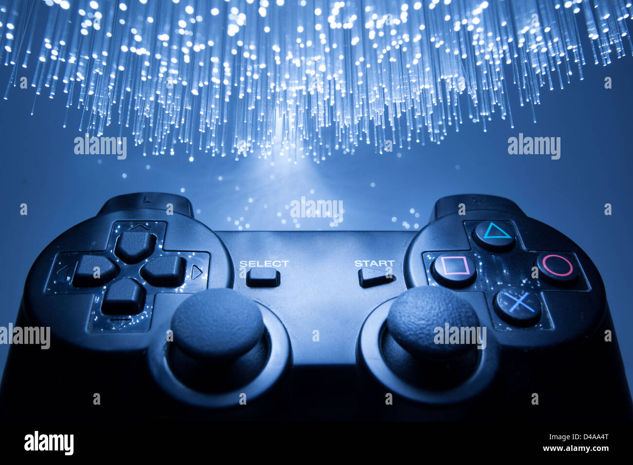 Game controller and blue light - Stock Image