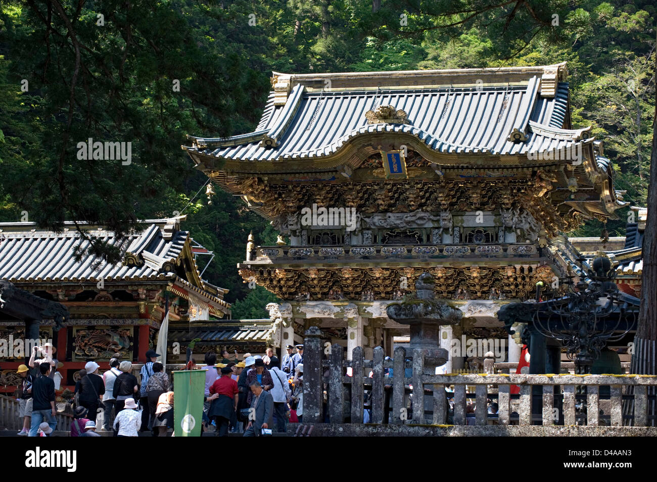 Crowds of visitors passing through the ornate Yomeimon Gate at the top of stone steps at Toshogu Jinja Shrine in - Stock Image