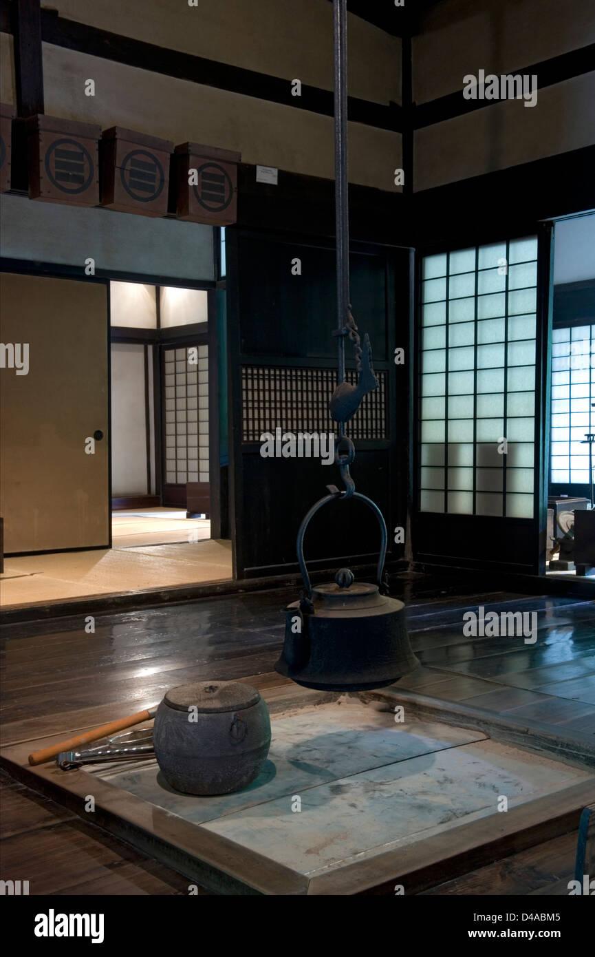 Village Folk House Interior With Irori Fire Pit And Jizaikagi Hanging Iron  Pot And Fish Shaped Adjuster At Nihon Minkaen