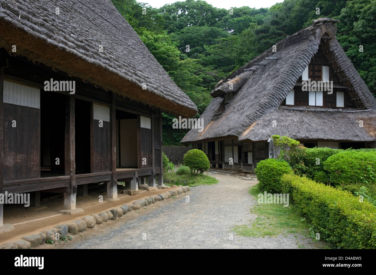 Historic countryside kayabuki thatched-roof village farm houses at the Nihon Minkaen open-air folk museum in Kawasaki, - Stock Image
