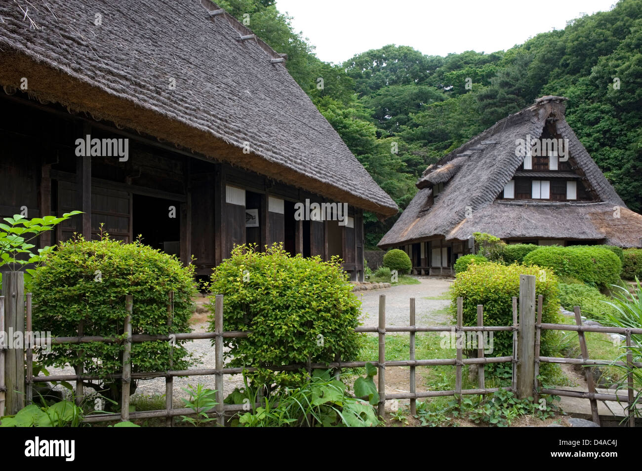 Thatched roof historic village farm residences at Nihon Minkaen (Open-air Folk House Museum) in Kawasaki, Japan. - Stock Image