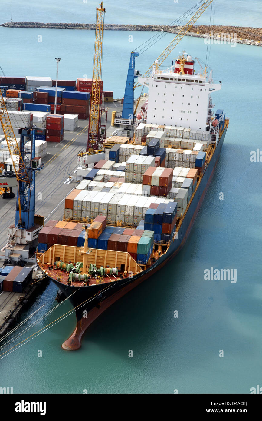 The container ship Kota Lukis being loaded at the port of Napier in New Zealand - Stock Image