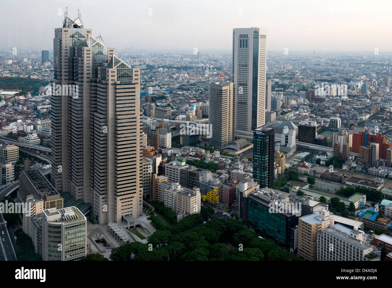 Aerial view of downtown Tokyo city skyline with skyscraper buildings including the Park Hyatt Hotel Tower and urban - Stock Image