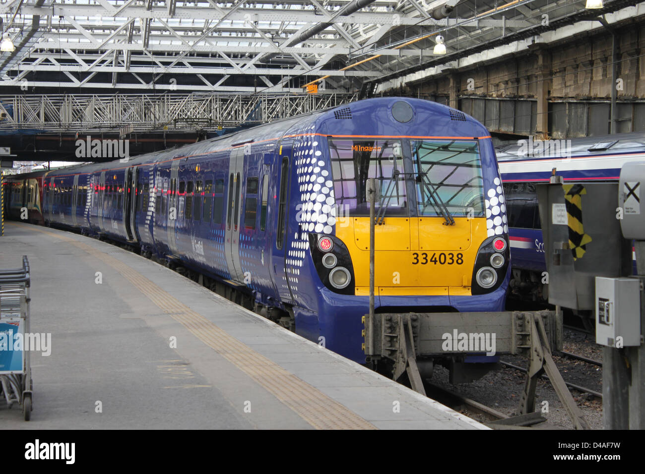 Class 334 Scotrail electric multiple unit (EMU) at a platform in Edinburgh Waverley station with a service to Milngavie. - Stock Image