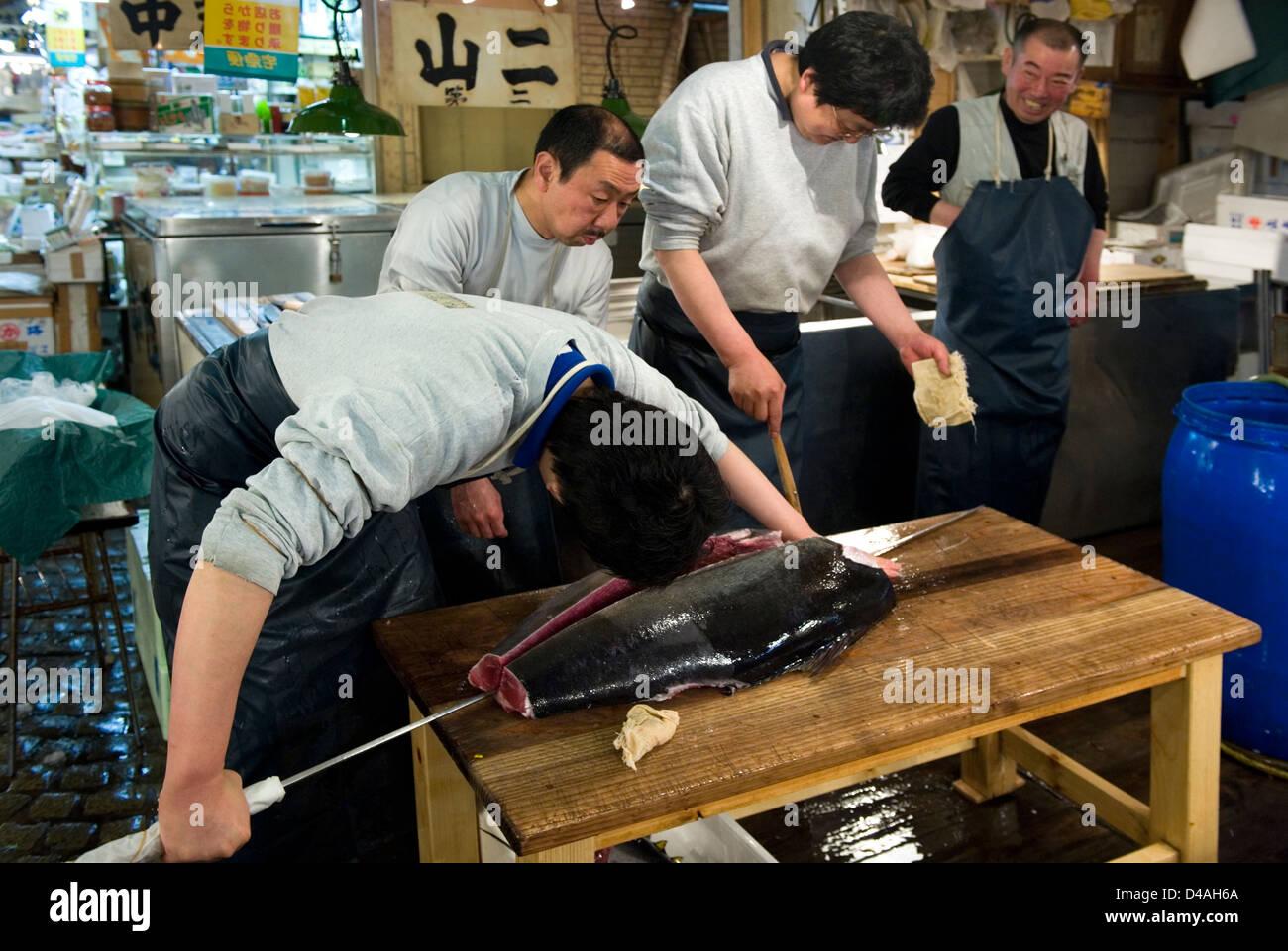 Fishmonger Cuts Fresh Raw Tuna With Giant Sharp Knife At