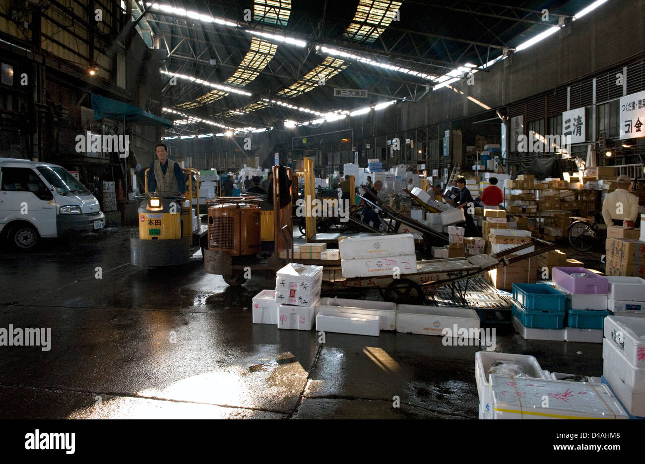 Sunlight filters in through skylights in the distribution and packaging section of Tsukiji Wholesale Fish Market - Stock Image