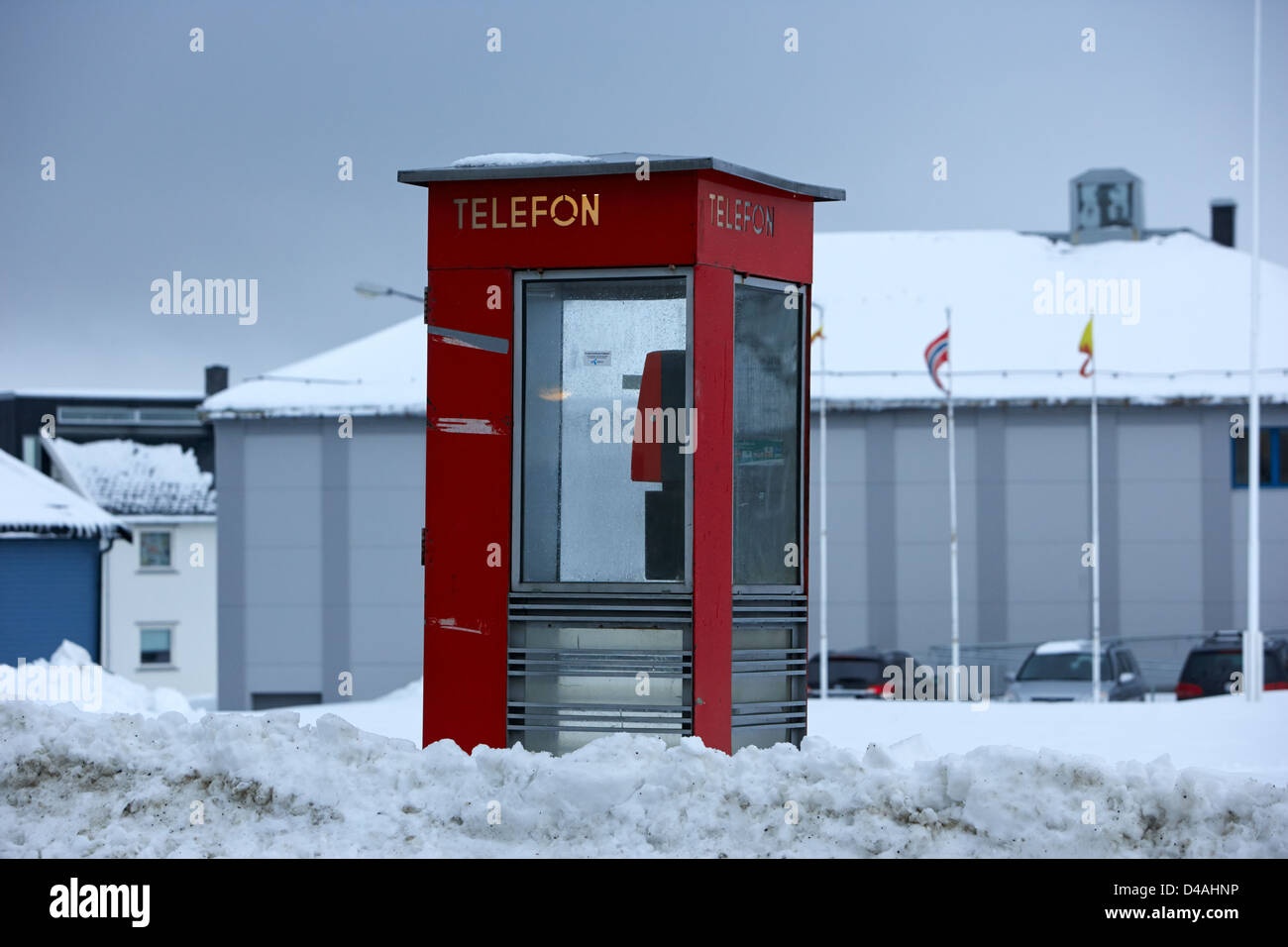 red norwegian telenor telefon box buried in the snow norway europe - Stock Image