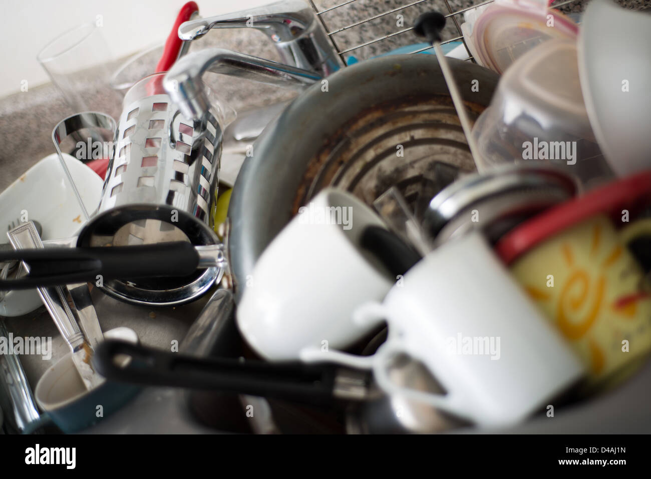 This is an image of a sink full of dirty dishes. - Stock Image