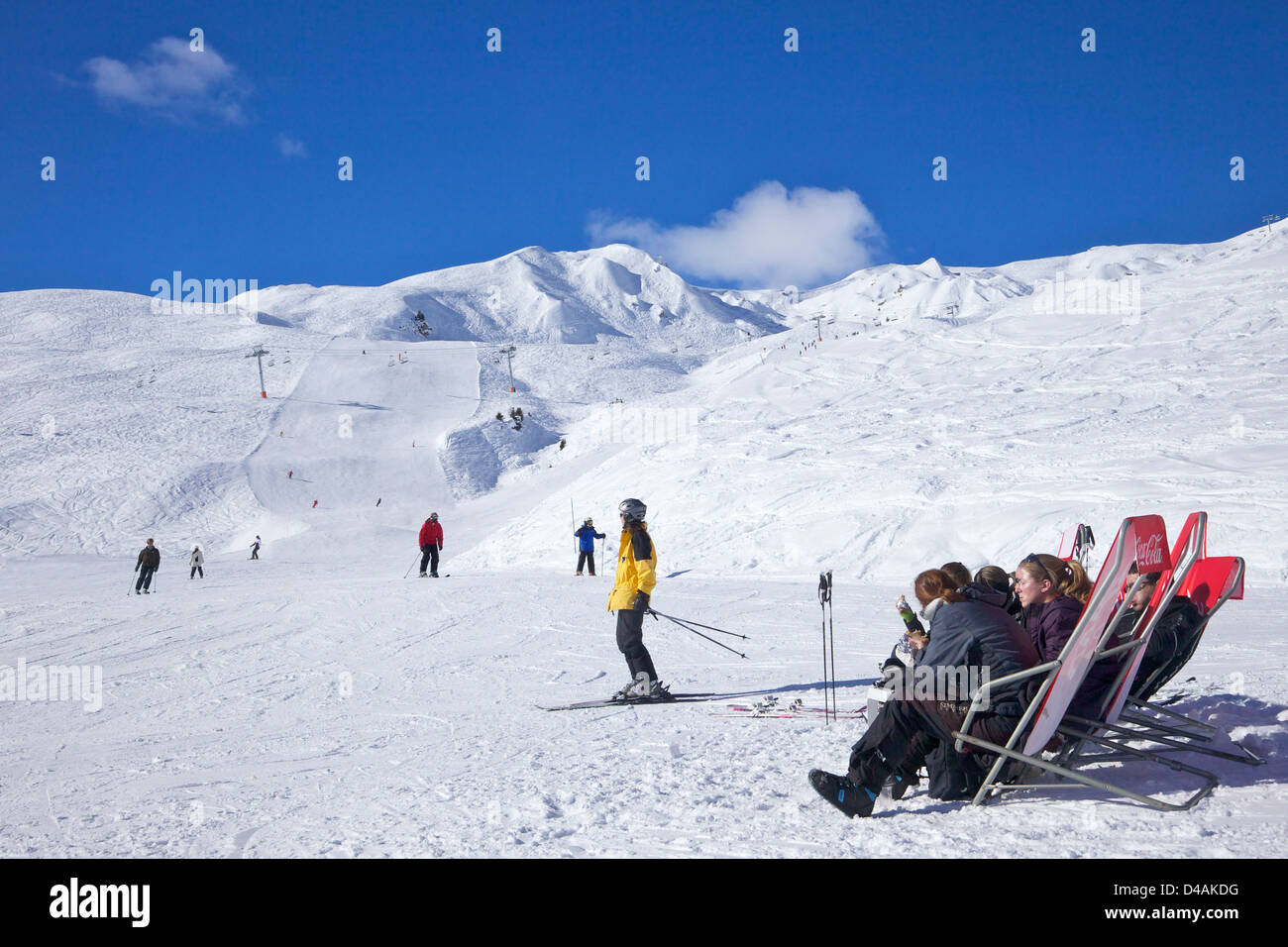 Skiers relaxing at cafe in winter sunshine, Verdons Sud, La Plagne, France, Europe - Stock Image