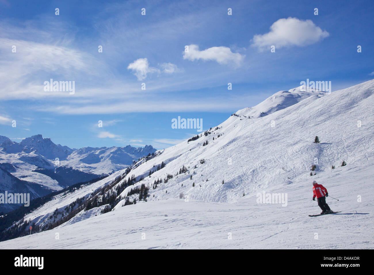 Skiers in winter sunshine, Verdons Sud, La Plagne, France, Europe - Stock Image