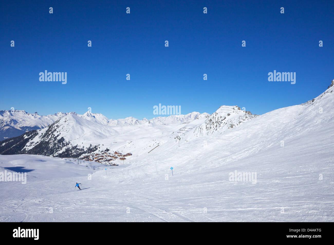 Les Blanchets blue piste, winter sun, La Plagne, France, Europe - Stock Image