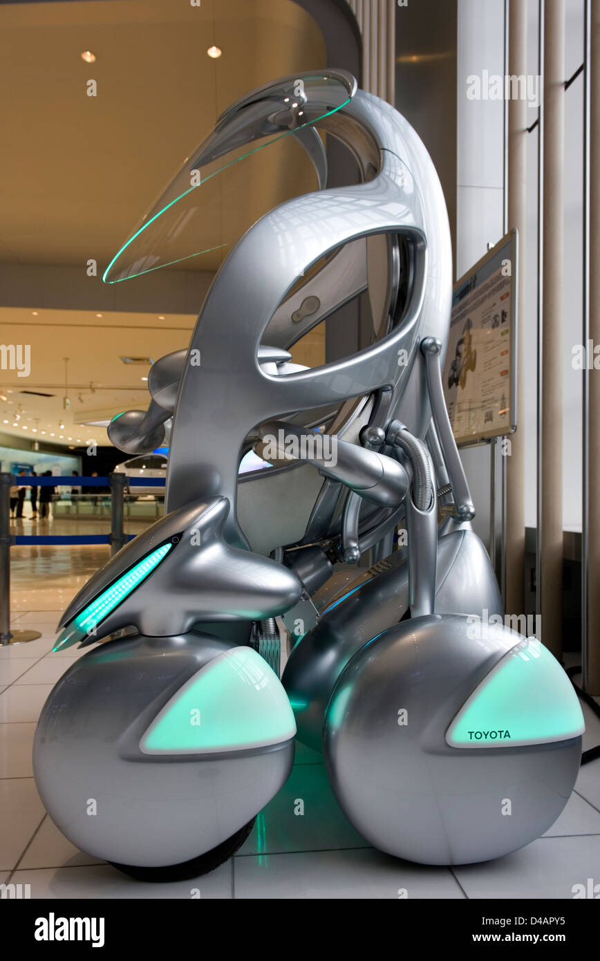 Side profile of a silver 'iUnit Personal Transportation Module' on display at the Toyota Kaikan Visitor's - Stock Image