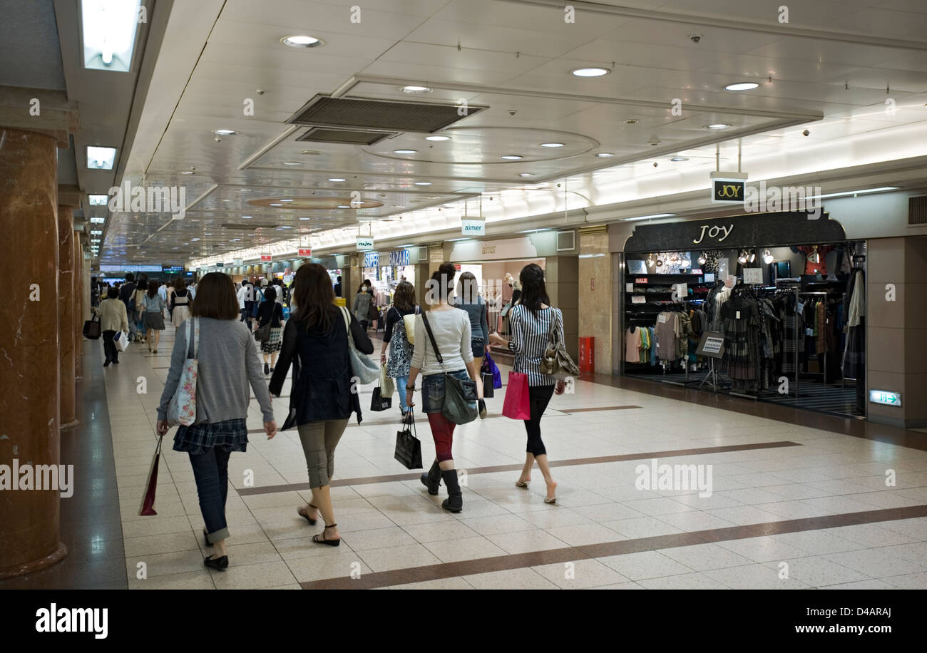 An underground retail shopping mall busy with shoppers looking for a bargain under the streets of Nagoya City in - Stock Image