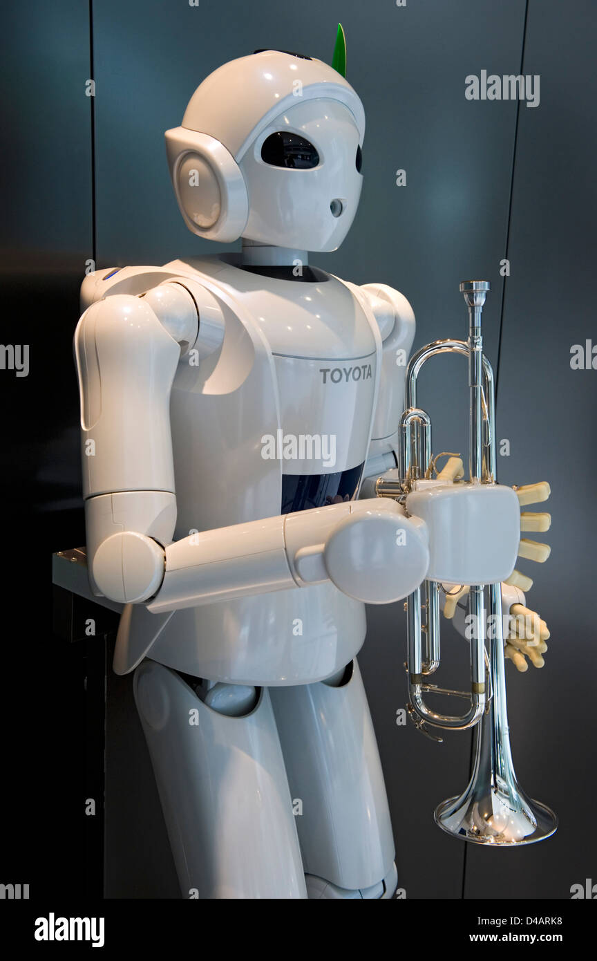 A white, humanoid, trumpet-playing 'Toyota Partner Robot' on display at the Toyota Kaikan Visitor's - Stock Image