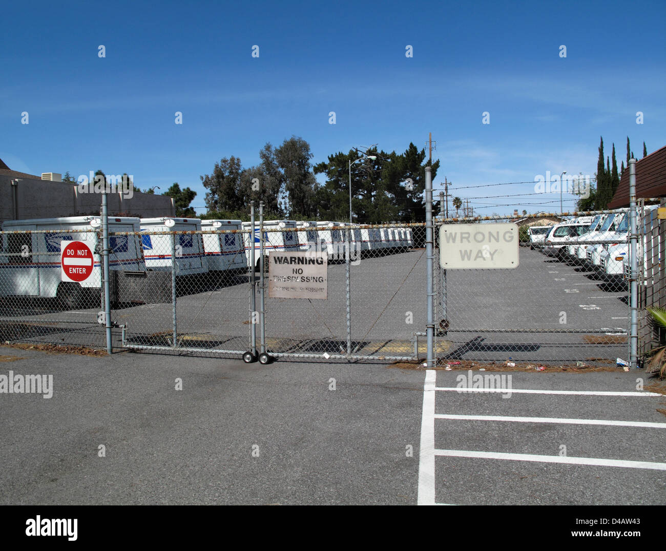 US Postal Service postal vehicles parked behind lock gate. Cambrian Post Office, San Jose California - Stock Image