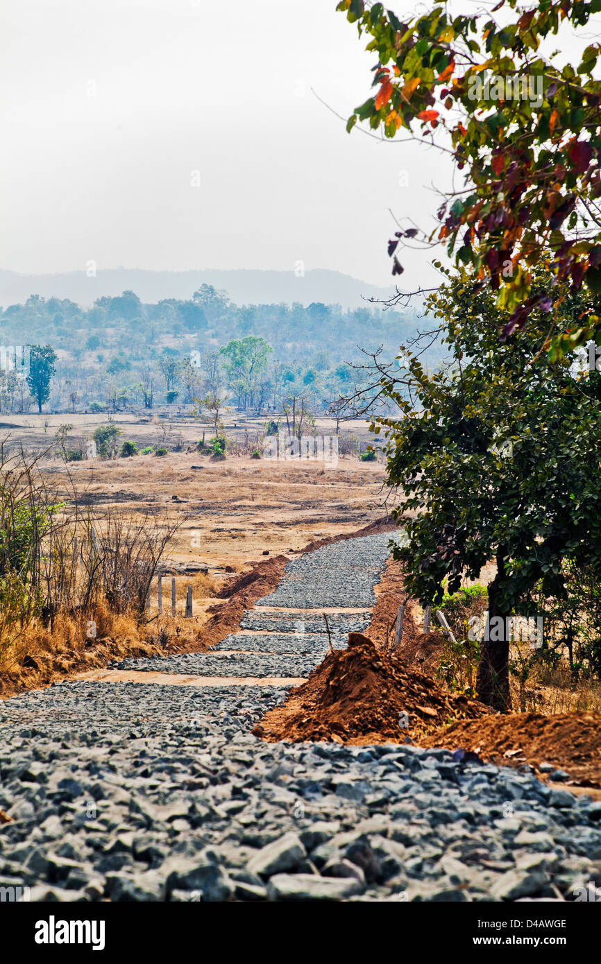 New road building in the rural countryside of Maharashtra India - Stock Image