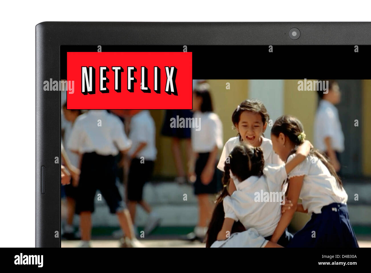 Watching a movie via Netflix online streaming on a laptop computer, UK - Stock Image