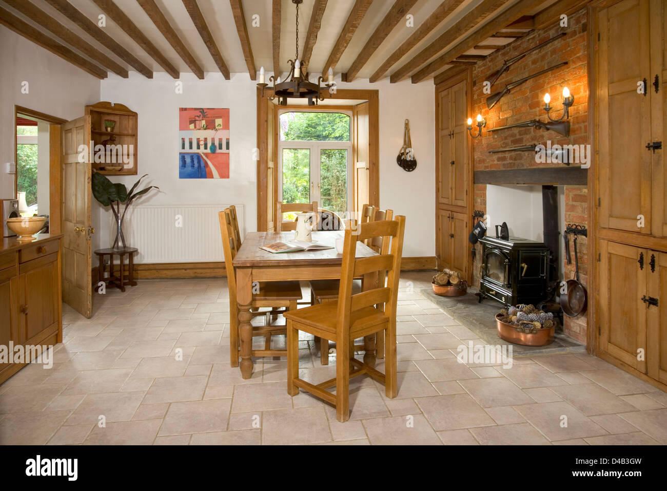 Picture of: A Large Country Style Dining Room With Exposed Brick Walls And A Stock Photo Alamy