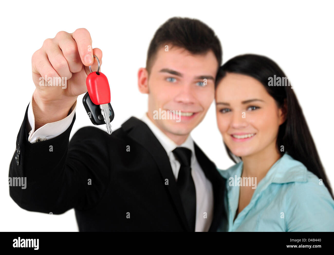 Isolated young business couple with car key Stock Photo